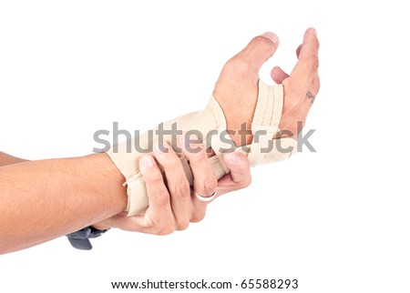 Man's Hand in Wrist Brace Due to His Wrist Pains
