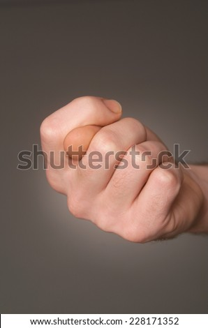 Man\'s hand keeping fingers crossed