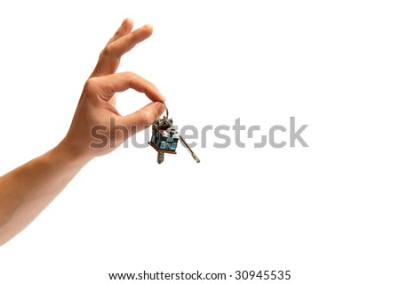 Man's hand keeping keys from a new house