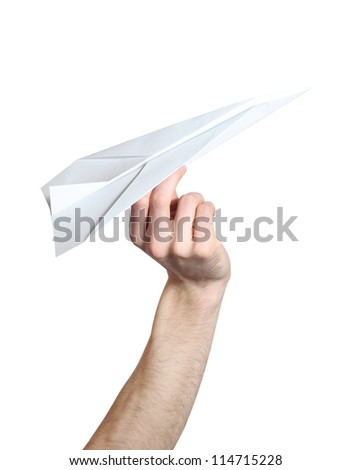 Man's hand launching white paper airplane isolated on white background.