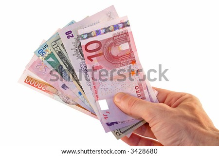Man's hand offering a range of currencies