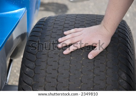 Man's Hand on Sports Car Tire