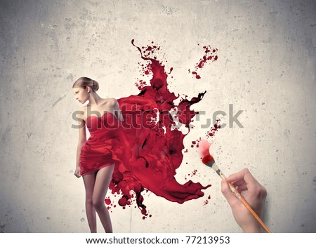 Stock Photo Man's hand painting the elegant dress of a beautiful woman