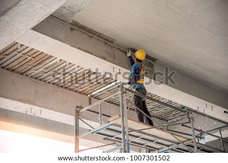 Man's hand plastering a wall with trowel. Construction worker. Masonry tool. Construction industry