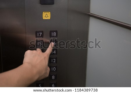 Man's hand press the elevator button #1184389738