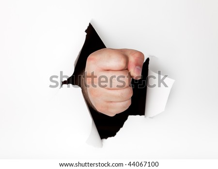 Man's hand punching a hole through a white paper background