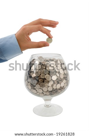 man's hand puts money into the glass - stock photo