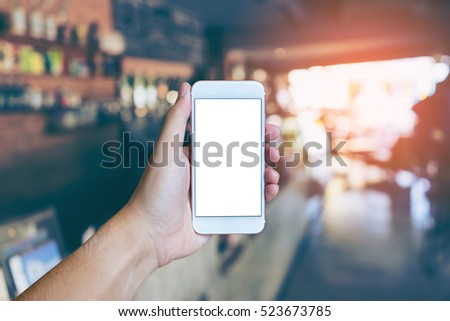 man's hand shows mobile...