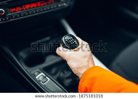 Man's hand switches manual transmission closeup Stock photo ©