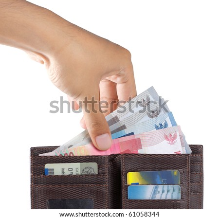 man's hand taking indonesia money from wallet