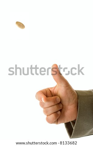 Man's hand throwing up a coin to make a decision