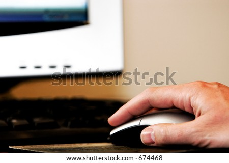 Man's hand using a computer mouse - work, school, surfing the internet, etc.