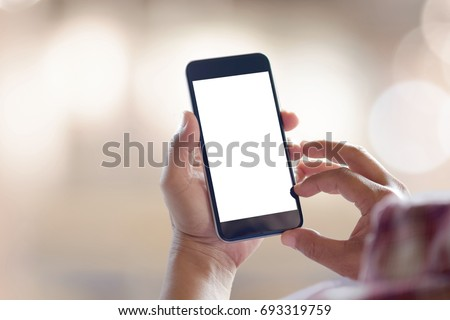 Man's hand using cellphone outdoor, Man typing text message on smart phone, Blurred background