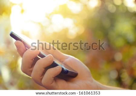 Man\'s hand using mobile smart phone