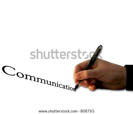 Man's hand with a pen writing and/or signing, with the word Communication - isolated over white background.