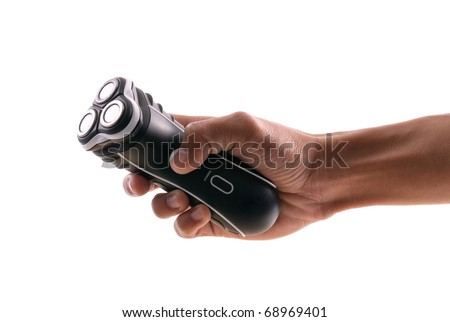 Man's Hand with an Electric Shaver