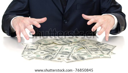 man's hands above the heap of dollars