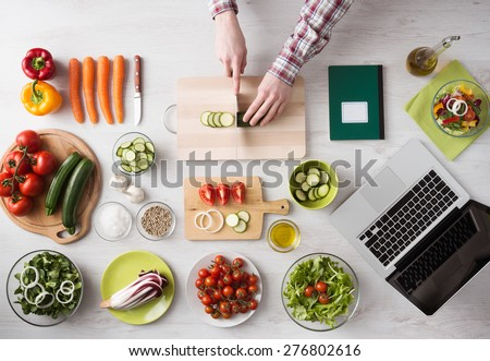 Home and chopping fresh vegetables on a cutting board kitchen tools