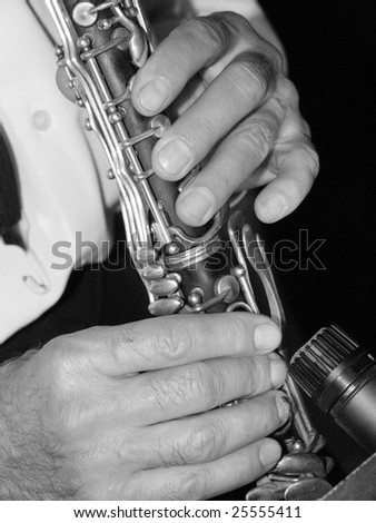 Man's hands playing a clarinet