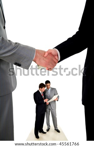 man's handshake and the transfer of money, hands closeup and two young businessmen in work