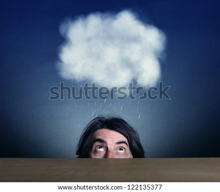 man's head looking up at the cloud and rain. - stock photo