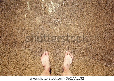 Man's legs on the sand beach and sea waves #362771132