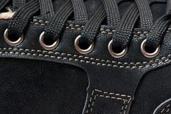man's new black shoes, closeup