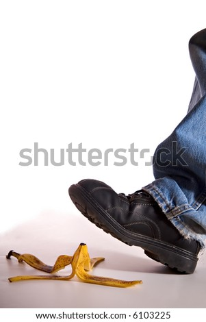 Man's shoe about to step on a banana peel and fall