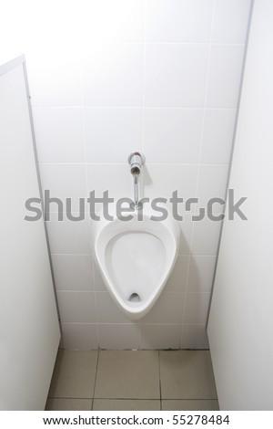 Man's toilet. Urinal