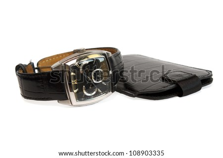 man's watch with a leather belt and black leather cover isolated on the white background