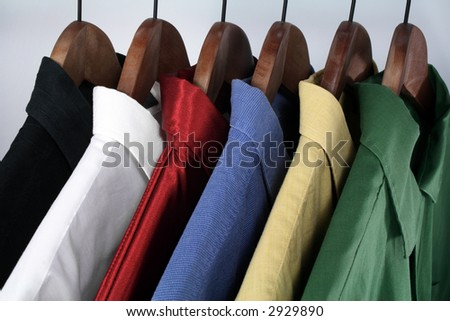 Man's wear: choice of colorful shirts on wooden hangers.