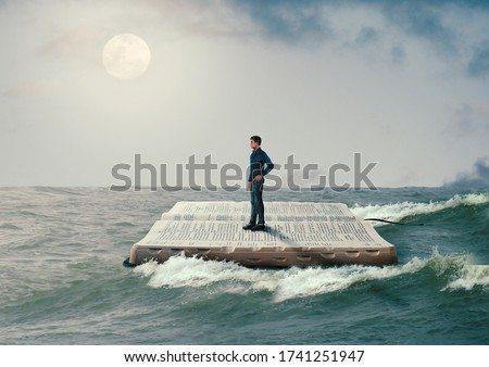 man sailing on the Holy Bible, in rough seas, seeking salvation by faith in Jesus Christ, Son of God. Biblical concept of Christianity Foto stock ©