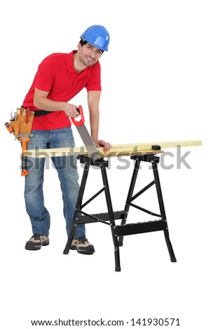 Man sawing plank of wood