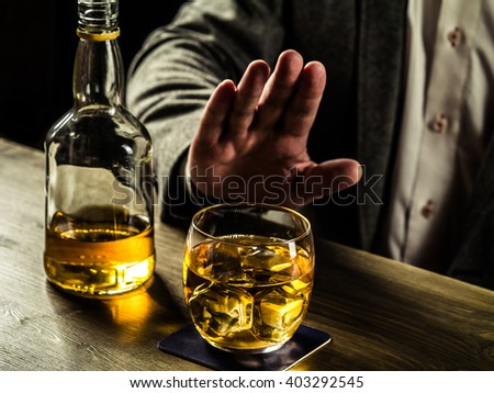 Man saying no more to alcohol with his body language