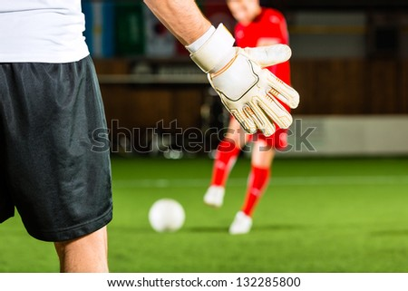 Man scoring a goal at indoor football or indoor soccer - stock photo