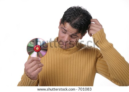 Man scratching head looking at CD disc