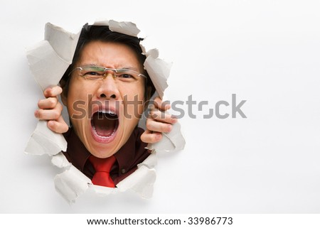 Man screaming from the hole in wall with copy space in horizontal position