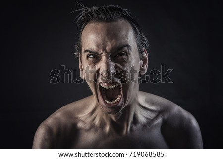 Man screaming with maddening and overwhelming rage