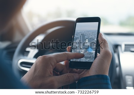 Man searching destination direction or address on gps or navigator application via  mobile smartphone inside a car while driving car, close up #732226759
