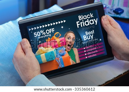 man searching website internet store to purchase gifts online in Black Friday with your tablet in you home / hands of a man at a website with an announcement concept for black friday deals