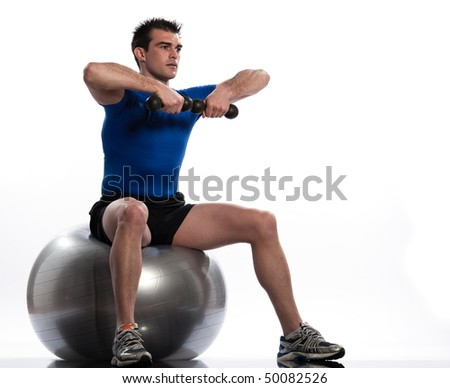 man seat on a swiss ball on a white background