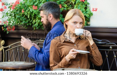 Man secret messaging cheating on wife. Cheat and betrayal. Family weekend. Married lovely couple relaxing together. Couple cafe terrace drink coffee. Couple in love sit cafe terrace enjoy coffee. #1380693326