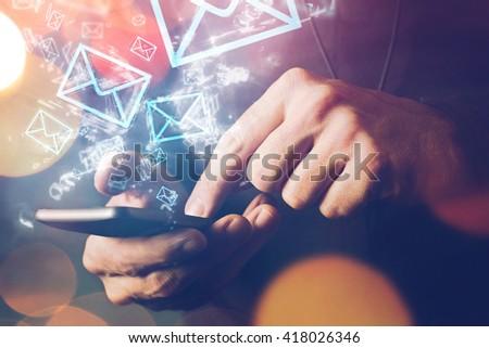 man sending e mail message to...