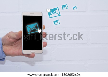 man sending messages of love with the mobile phone