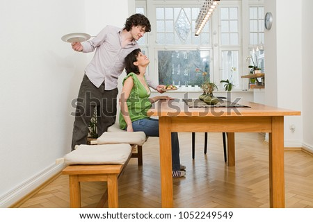 Man serving his partner a meal #1052249549