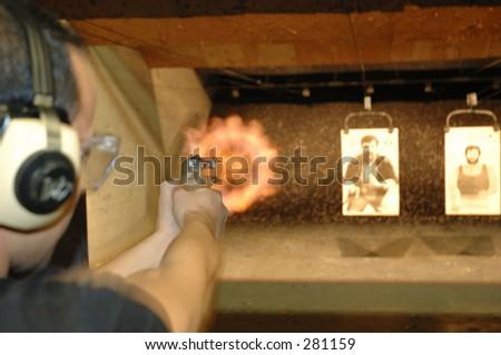 Man shoots at gun range.