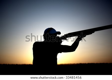 Man shoots with his gun silhouette