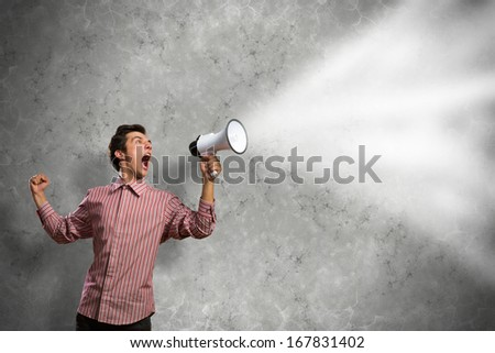 man shouts through a megaphone. from megaphone off clouds