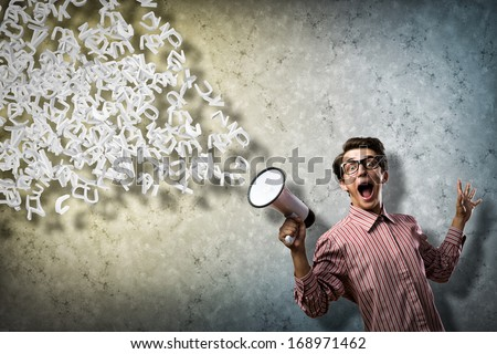 man shouts through a megaphone. from the megaphone off abstract symbols