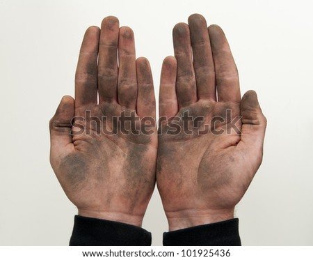 Man show his dirty hands with palms up isolated on white.